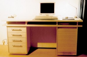 A custom made desktop (maple ) with drawers and a sliding door.